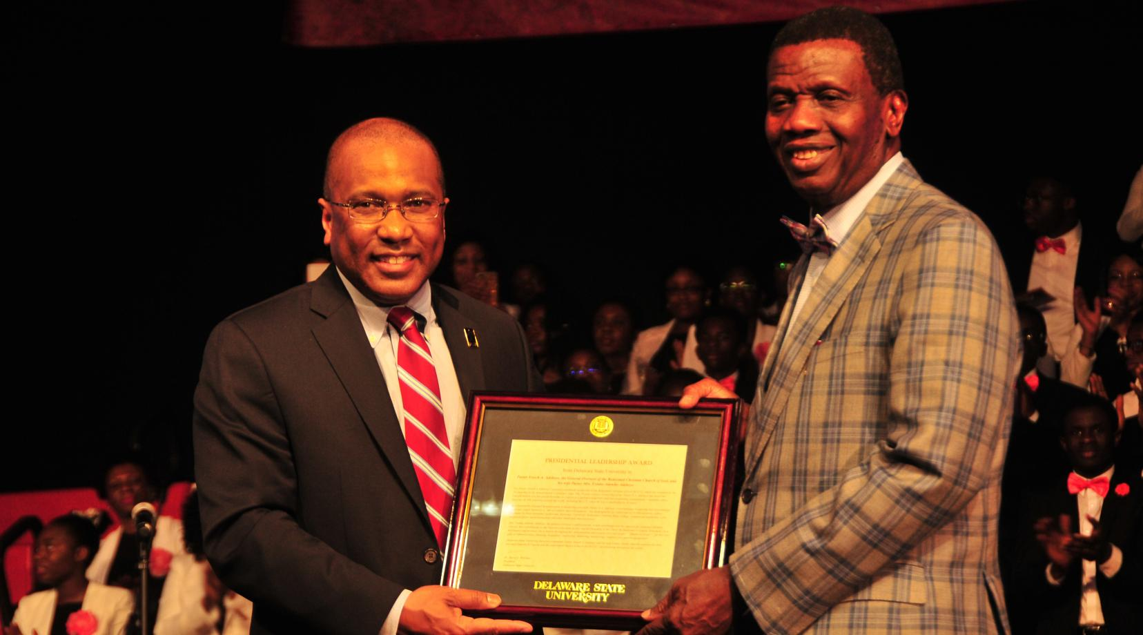 <p>DSU President Harry L. Williams presents Enoch A. Adeboye, worldwide general overseer of the Redeemed Christian Church of God, with the President's Leadership Award during the denomination's Holy Ghost Festival of LIfe held at DSU on Feb. 24.</p>
