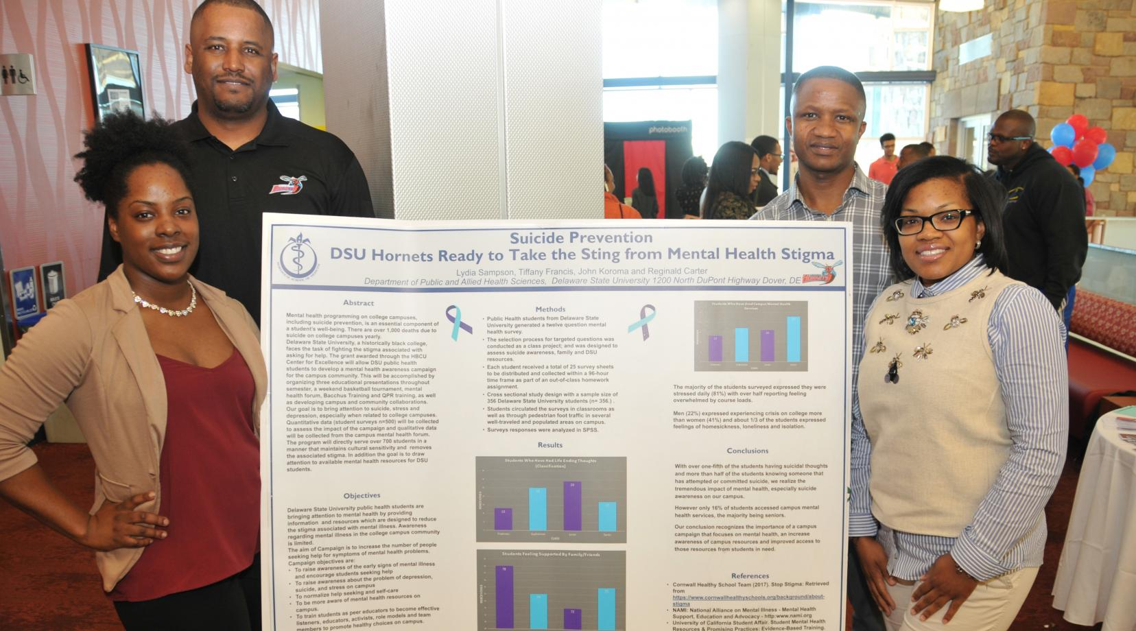 The first-place research poster winning team: (l-r) Lydia Sampson of Lewes, Del., Reginald Carter of Marydel, Md.; John Koroma from Sierra Leone, West Africa, and Tiffany Francis of Middletown, Del. All are senior Public Health majors at DSU.