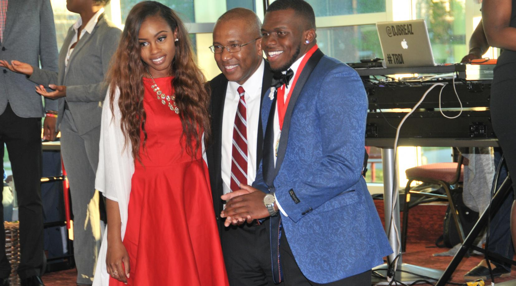 <p>DSU President Harry L. Williams (center) poses with the newly elected 2017-2018 Mr. and Miss DSU, Michaela J. Rose (l) and Kevin Perry.</p>
