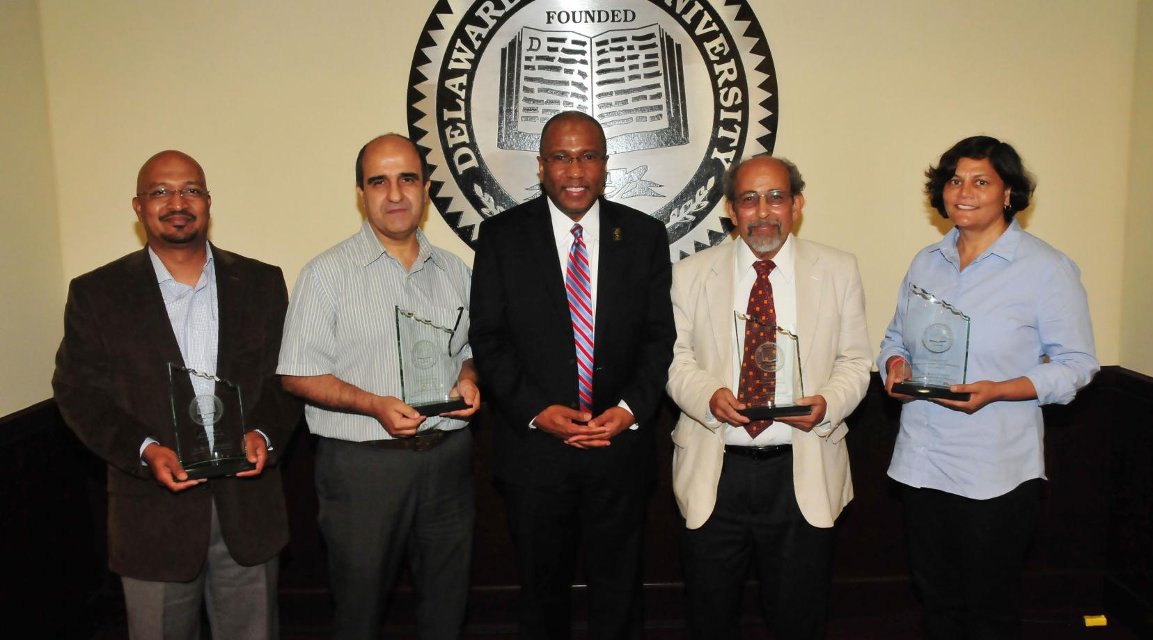The  2017 DSU Faculty Excellence Awardees: (l-r) Dr. Murali Temburni (Teaching), Dr. Hacene Boukari (Service), DSU President Harry L. Williams, Dr. Mazin Shahin (Advising), and Dr. Renu Tripathi (Research).