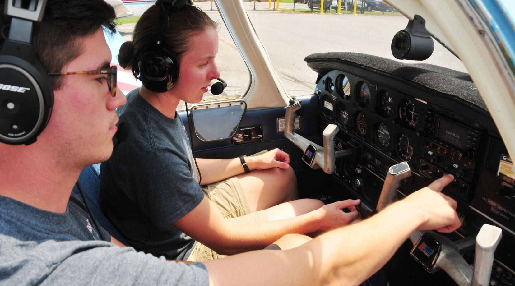 <p>Cadet Capt. Erin Dundas received cockpit instruction from DSU Aviation instructor Mark Ramos.</p>