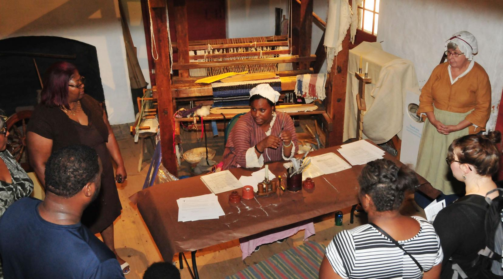<p>Armani McCoy explains the use of the quail pen during the 1700s to visitors at the John Dickinson Plantation.</p>