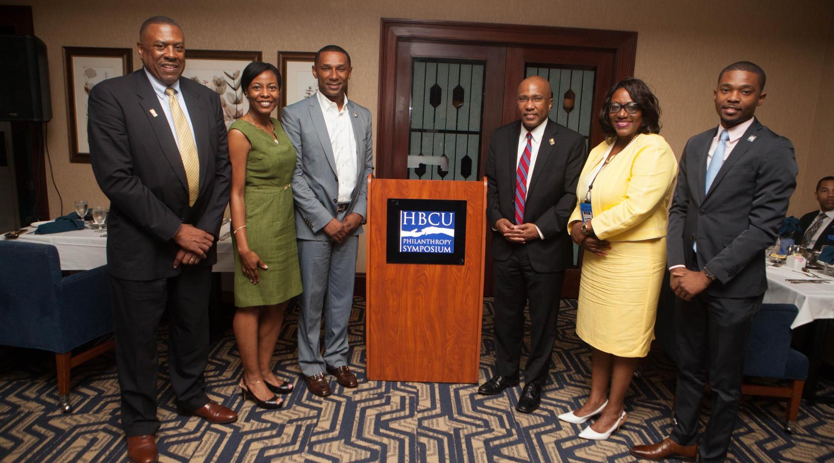 <p>(L-r) DSU alumnus and Board of Trustees member John Ridgeway, Emily Dickens TMCF Sr. VP, Johnny C. Taylor, TMCF president and CEO, DSU President Dr. Harry L. Williams, DSU Institutional Advancement VP Dr. Vita Pickrum, and Tony Hunter, TMCF assistant to the president. (TMCF -- Thurgood Marshall College Fund).</p>