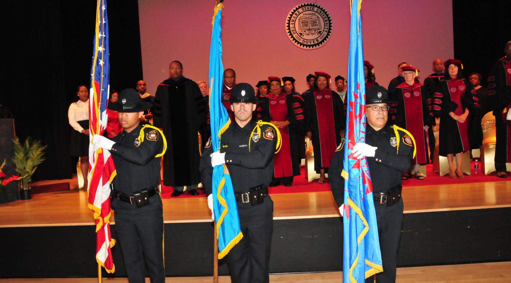 The DSU Police Honor Guard -- (l-r) Ptlm. Teddy Tyson, Ptlm. Anthony Sapienza and Ptlm. Jorge Camacho -- present the flags for the opening National Anthem during the Convocation Ceremony.