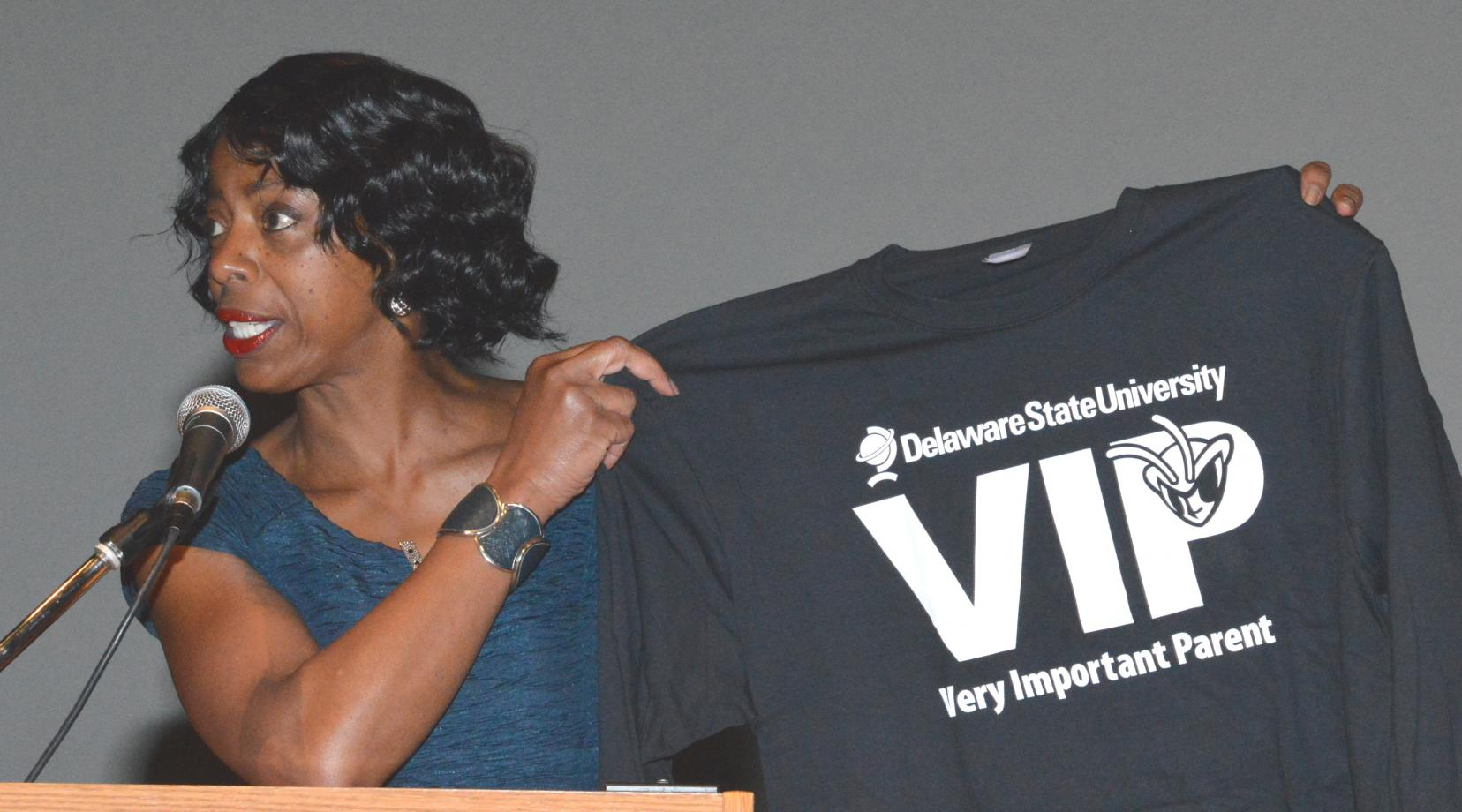 <p>Brenda Farmer, emcee of the Parents and Family Day program, shows off a shirt designed especially for the visiting DSU parents.</p>