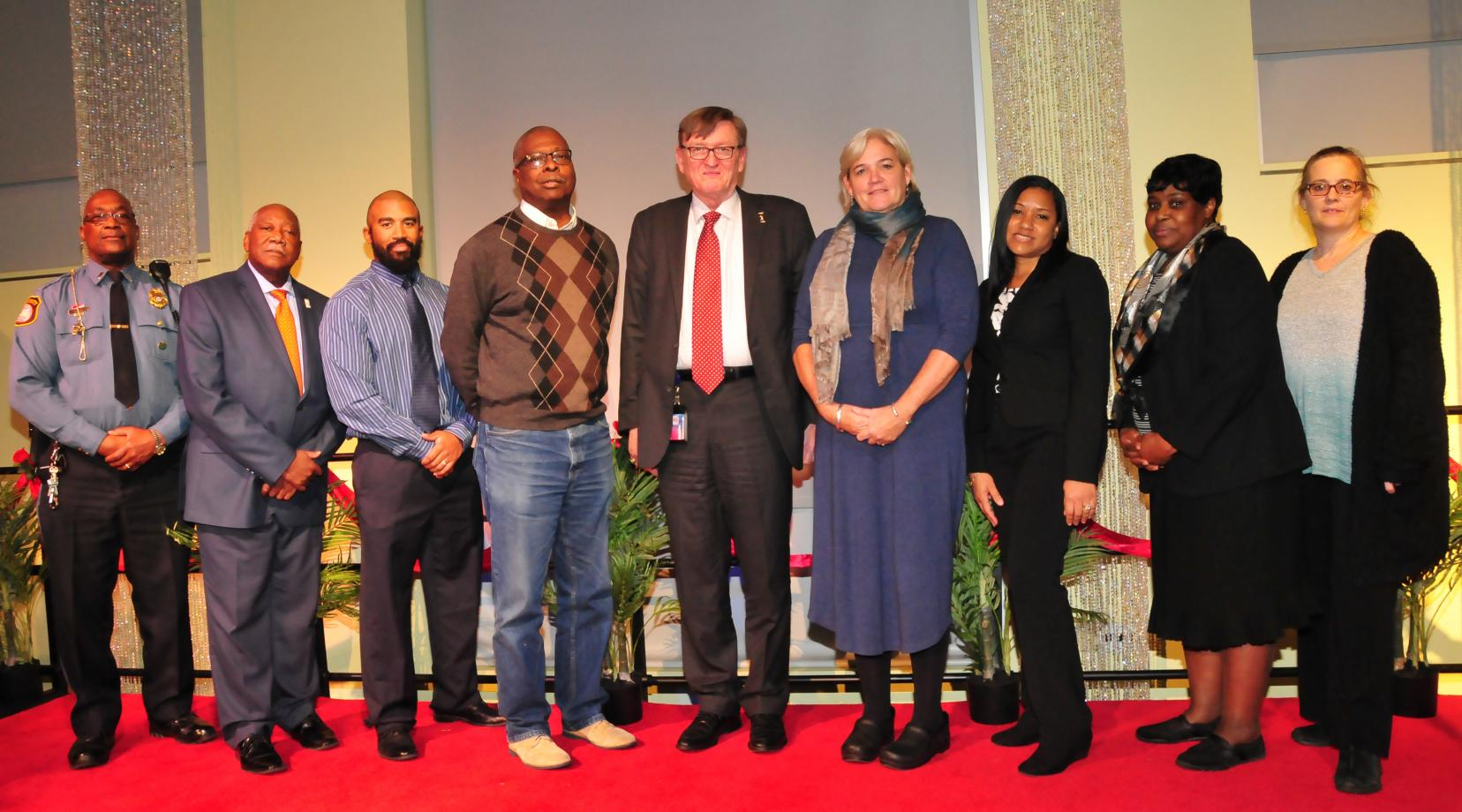 Delaware State University's 2017 Vice Presidents Choice Award recipients: (l-r) Lt. Russell Smith, Bryant T. Bell, Joel Welsh, Dennis Jones, Dr. Bradley Skelcher, Dr. Alexa Silver, Jadeen Notice, Henrietta Savage and Crystal Canon.