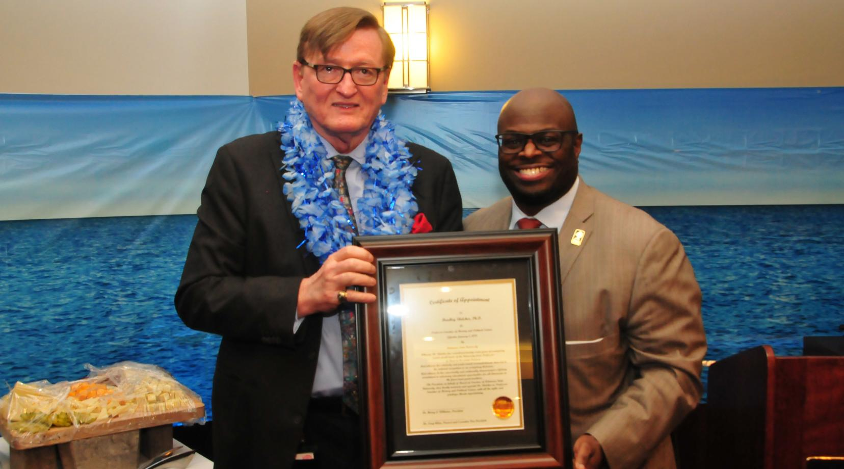 "Dr. Bradley Skelcher (l) receives the University's title of ""Professor Emeritus"" from Provost Tony Allen."