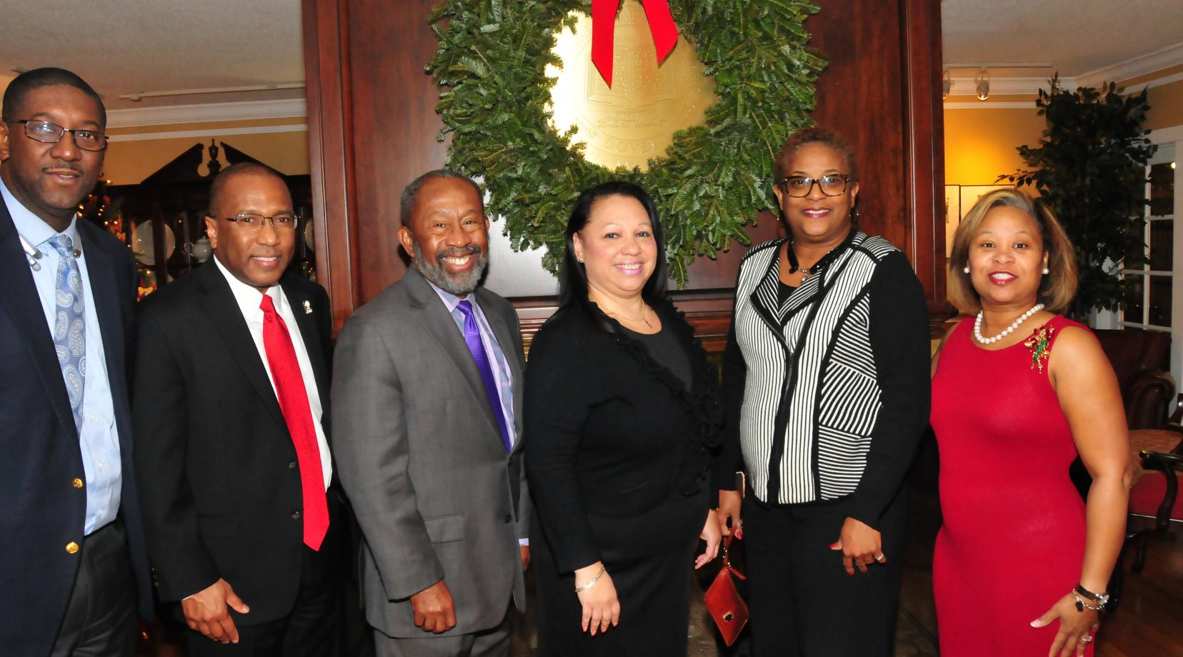 These DSU employees were one of many who took advantage of one more opportunity to get their picture taken with the DSU president and the First Lady during the annual Christmas Open House.