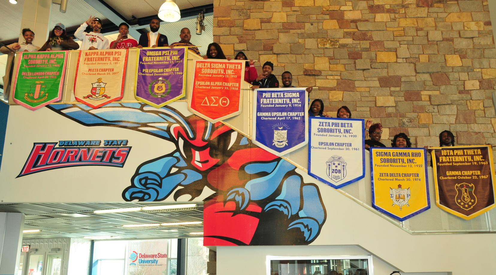 The Divine Nine fraternities and sororities show off their banners that will be hung in the MLK Jr. Student Center.