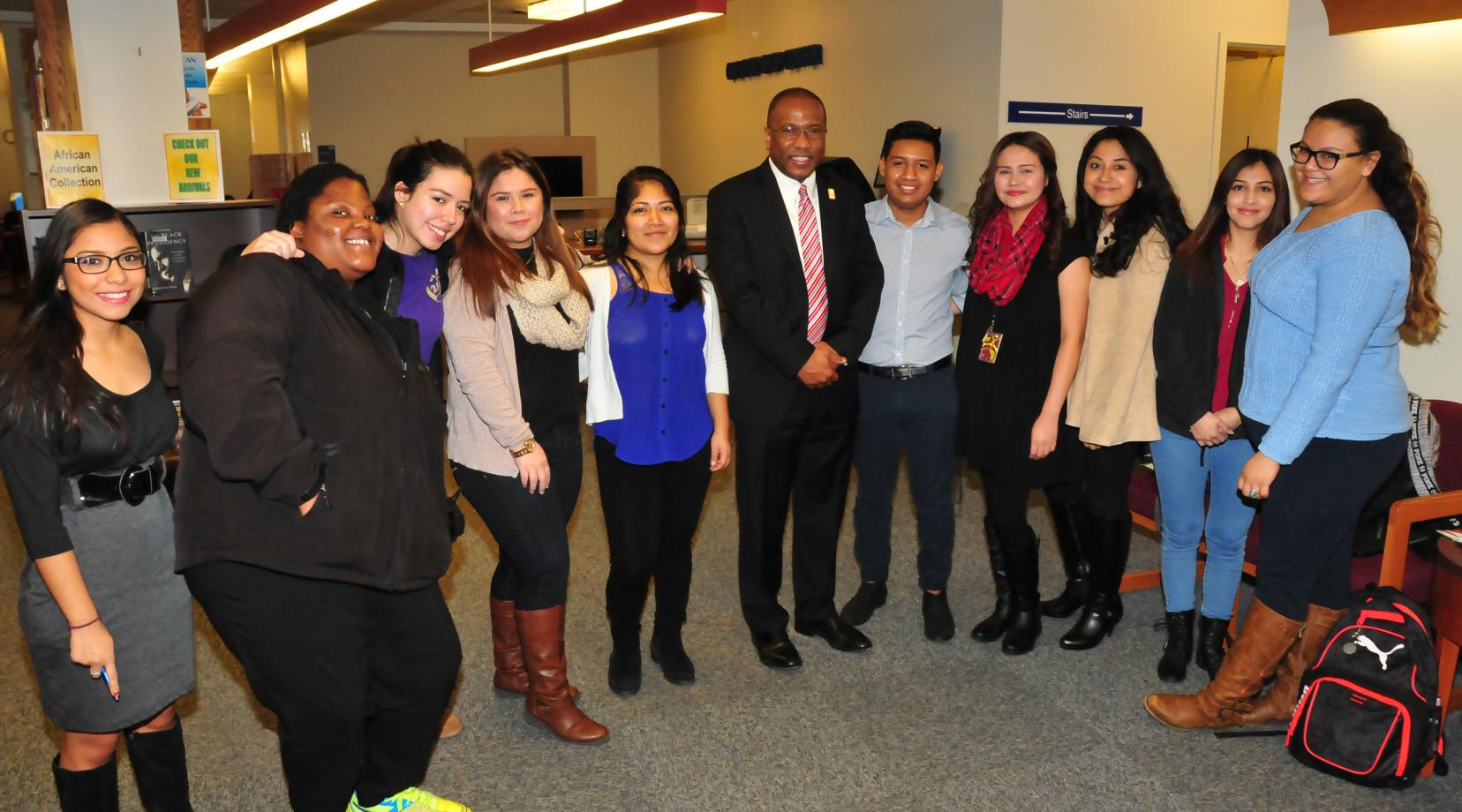<p>Dr. Harry L. Williams in a 2016 photo with a group of the DSU Dreamers</p>