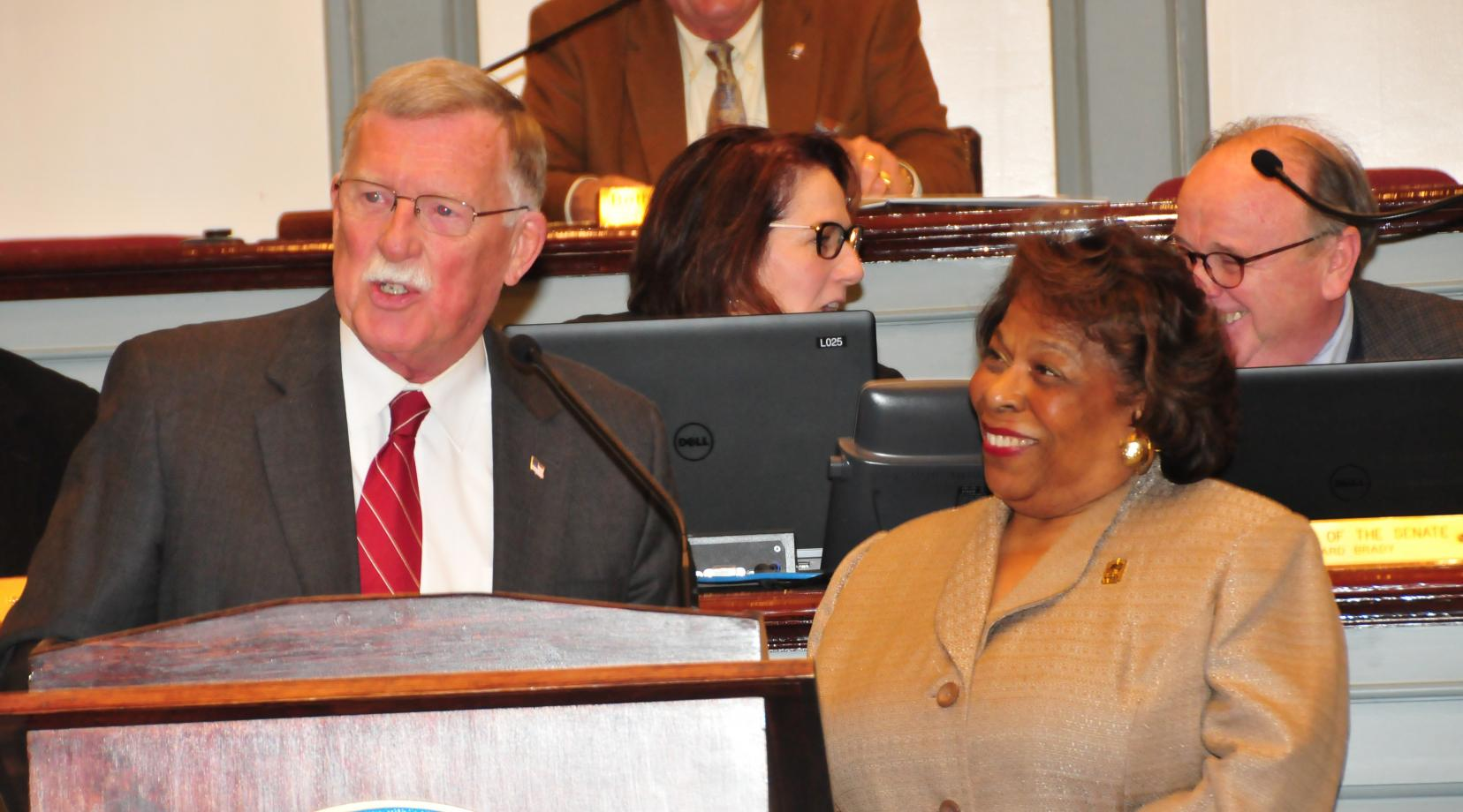 <p>State Sen. Brian Bushweller presents a formal tribute in honor of interim DSU President Wilma Mishoe during the Jan. 25 session of the Delaware Senate.</p>