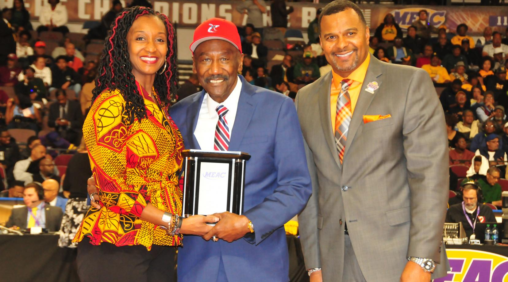 <p>Robert P. Vanderhost (center), DSC class of 1972, was among the 2018 MEAC Alumni of the Year. He is shown March 8 at the MEAC Basketball Tourney accepting the award from two conference officials.</p>