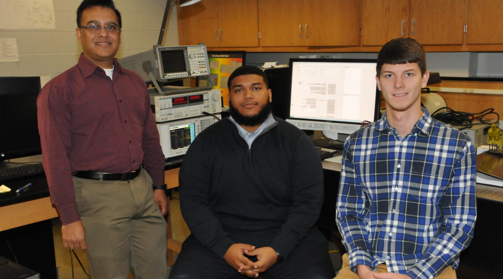 <p>(L-r) Dr. Mukti Rana, chair of the Dept. of Physics and Engineering and the grant's principal investigator, with Danzel Hill and Andrew Voshell, undergraduate and graduate students, respectively. Both students are working with Dr. Rana on the research project.</p>