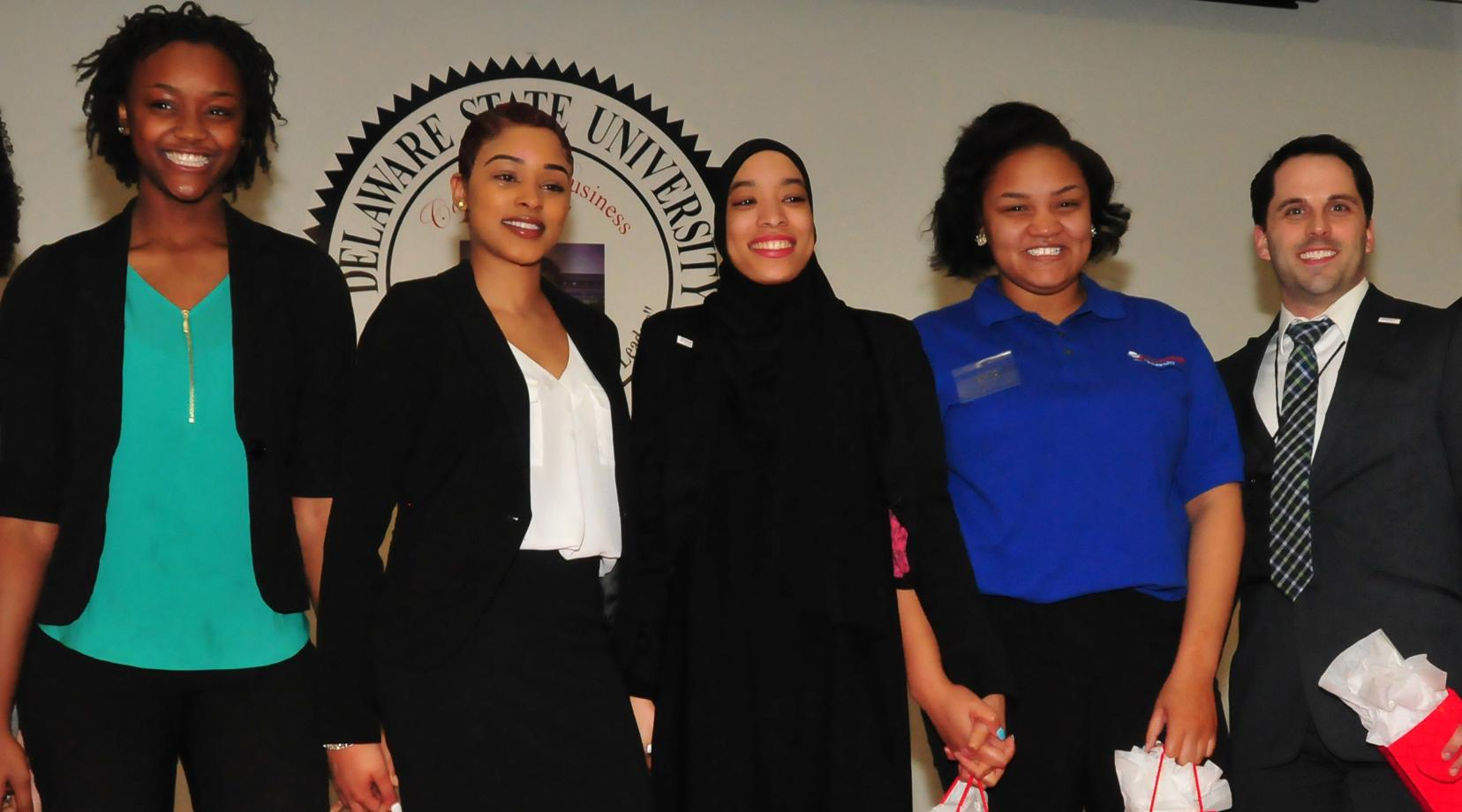 The Business Competition first-place En'Liven team: (l-r) Lashae Eden-Clemons, LaShae Billips, Alexis Sharif, Kia Abrams, along with their coach Brian Passerell. The team came up with the best plan to address homelessness.