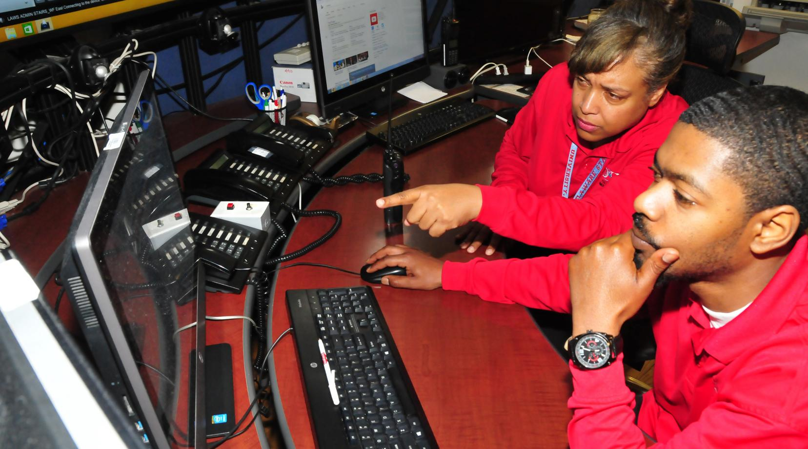 <p>DSU Police dispatchers Kimberley Wood and James Paige Jr. were among the dispatchers who were tested during the April 11 active shooter exercise on campus.</p>