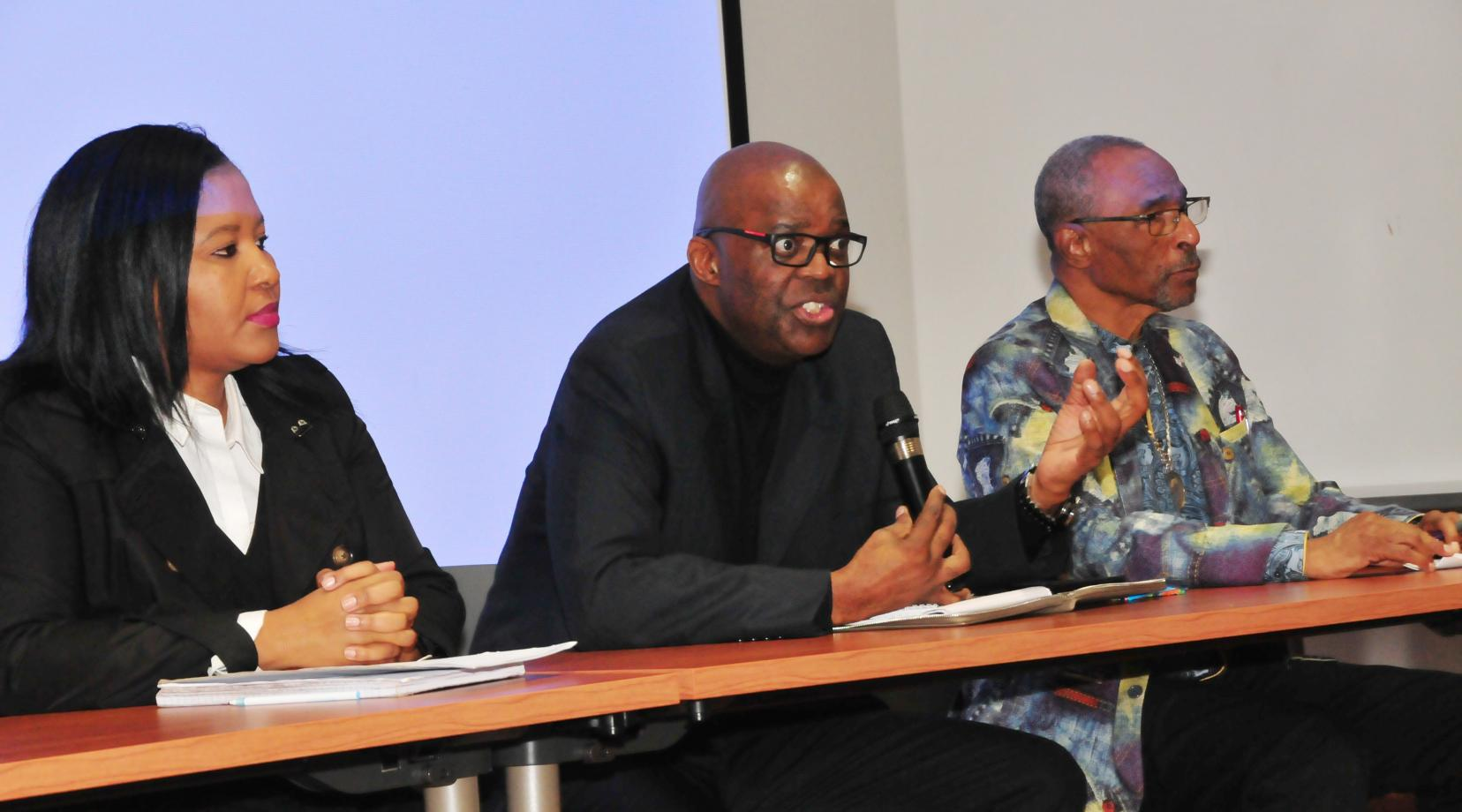 <p>Dr. Eddy Maloka (center), CEO of the African Peer Review Mechanism, fields a question from the audience of DSU students. He is flanked by Tumi Dlamini (l), Dr. Maloka's advisor, and C. Gregory Turner, of Kool-Baker Global, a firm that invests in businesses in Africa.</p>