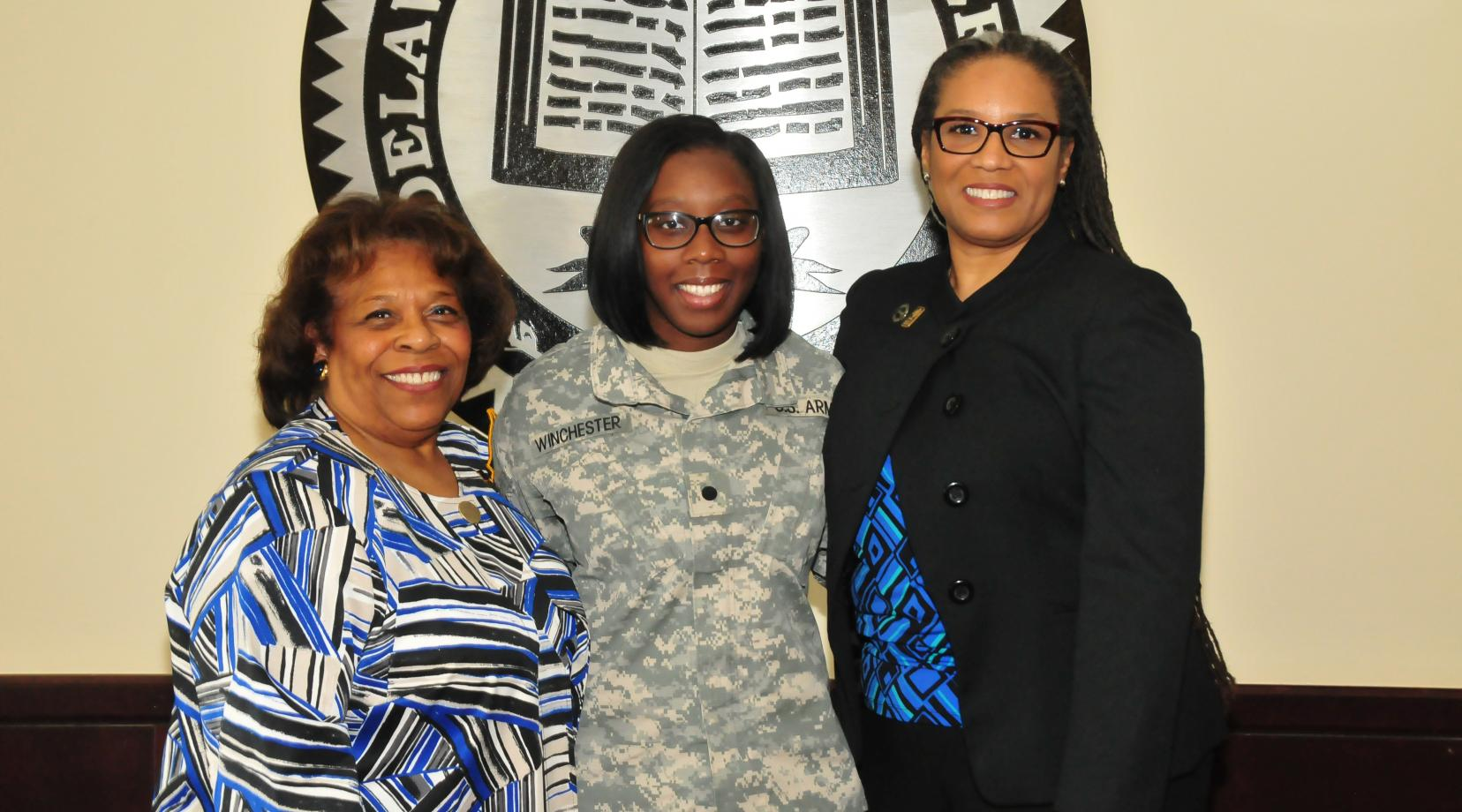 Alisa Winchester (center), a junior English major, stands with DSU Acting President Wilma Mishoe (l) and Dr. Adenike Davidson, professor of English. Just before the photo, Dr. Mishoe informed Ms. Winchester, also a ROTC cadet, that she has been awarded the prestigious Harry W. Truman Scholarship.