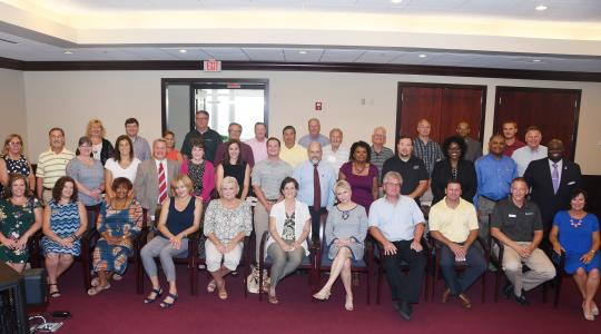 <p>A gathering of the Kent County Plant Managers group met July 17 at DSU and posed for a Kodiak moment.</p>
