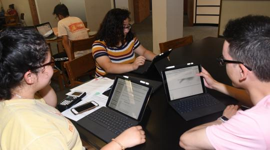 <p>(lL-r) Freshmen students Karine Hernandez, Estefany Bonilla and Filiberto Camarillo have easily incorporated their new Apple iPad Pros into their study sessions.</p>