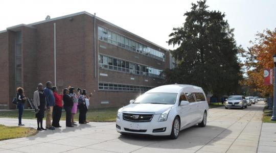 <p>The hearse carrying the body of Dr. Ulysses S. Washington take the former longtime head of the Department of Agriculture and Natural Resource a final trip through the campus after the Celebration of Life service held in the Education and Humanities Theatre. Photo by Bernard Carr.</p>