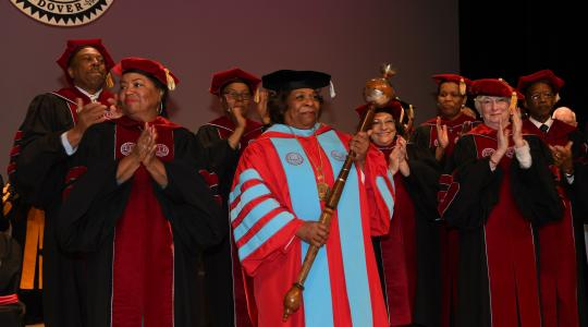 <p>Surrounded by the University's Board of Trustees, the institution's 11th President receives the applause of all those in attendance at the Investiture Ceremony in the Education & Humanities Theatre.</p>
