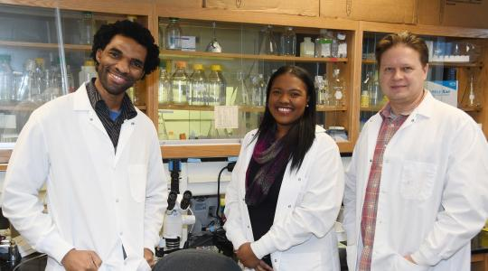 <p>(L-r) Dr. Hakeem Lawal, associate professor of biological sciences, and the awardees Shardae Showell and Sergei Grigoryev, both first-place winners in their respective categories. Not pictured is a third-place winner, Liam Joseph.</p>