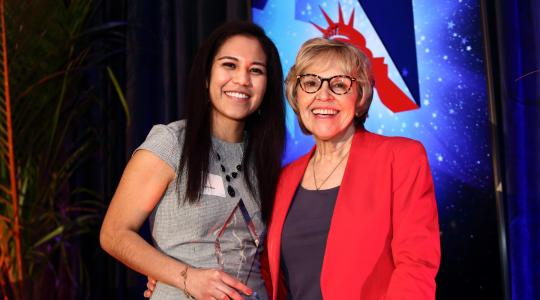<p>Indira Islas (l), with her Holly Skolnick Human Rights Awards from the Americans for Immigrant Justice, stands with the Cheryl Little, the organization's executive director. Ms. Islas received the award at a Feb. 8 ceremony in Miami, Fla.</p>