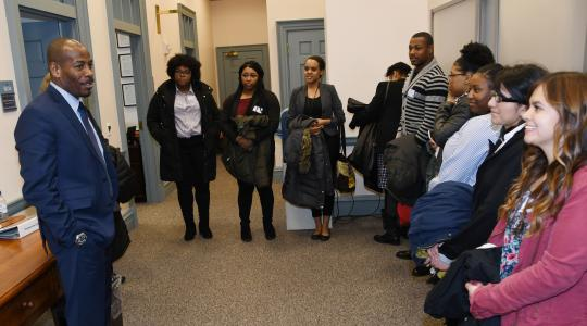 <p>Rep. Nnamdi Chukwuocha, a University alumnus, speaks to a group of DSU social work students outside of his office at Legislative Hall.</p>