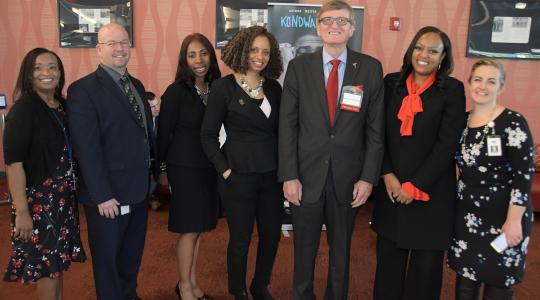 <p>DOE's Tiffany Cireen Jon Nembauer, Raushawn, Shelly Rouser, retired University Associate Provost Bradley Skelcher and Education Department Chair Shelley Rouser, DOE's Monique Martin and Shannon Holston gather for a photo during the summit.</p>