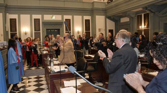 <p>The University's Concert Choir receives a standing ovation from the House of Representatives following an April 17 performance.</p>