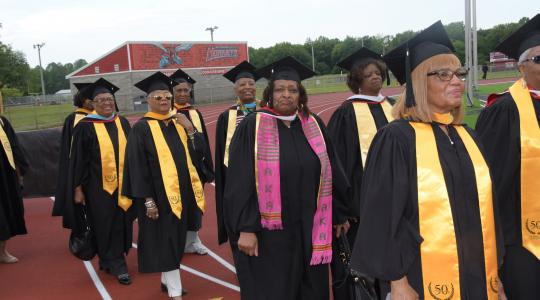 <p>The Class of 1969 march out onto Alumni Stadium to take part in the May 11 Commencement Ceremony.</p>