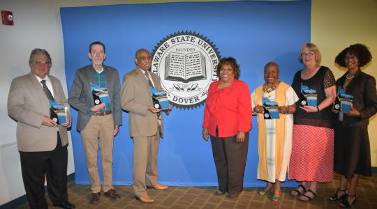 <p>(L-r) 2018-2019 retirees Dr. Peter DiMaria, Dr. Andrew Lloyd, Dr. John Austin, University President Wilma Mishoe (who unretired herself to be the institution&#039;s CEO), Dr. Dolores Finger Wright, Dr. Janet Hill and Dr. Sheridan Quarless Kingsberry.</p>