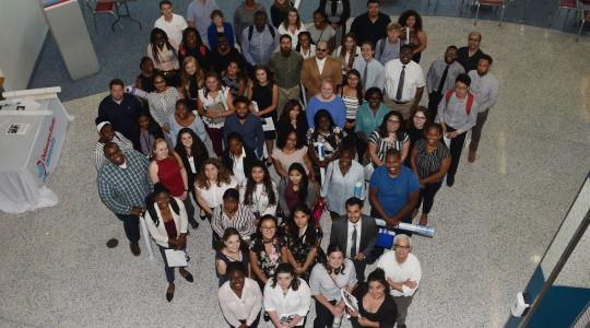 <p>The 2019 Summer Research Symposium participants pose for a group shot at the end of the July 26 event.</p>