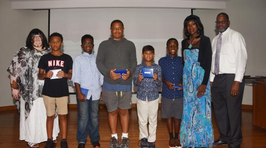 <p>The Verizon Summer Camp&#039;s 1st place team -- The Thinkers. (L-r Dr. Charity Shockley, camp director; Thinker team members Xavier Gordy, Christian Auguste, Tristan Cooper, Vraj Shah and Kinte Tolson; and camp co-directors Lillie Crawford and Vaughn Hopkins.</p>