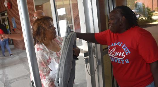 <p>University President Wilma Mishoe even got into the volunteer work of helping students and the families move their belongings into the residential halls.</p>