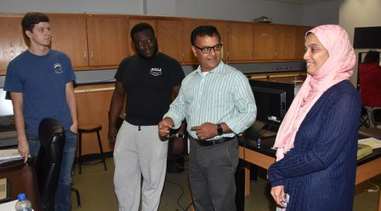 <p>The DoD funded X-ray Diffraction System will not only be used for ongoing and future research project, but also it will be used an advanced technology that science students (like the ones Dr. Mukti Rana is chatting with here) can be exposed to and trained to use.</p>