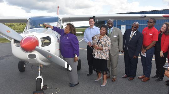 <p>University President Wilma Mishoe christens the Aviation Program&#039;s newest aircraft, which is the first of a new 11-plane fleet that slated to be delivered soon.</p>