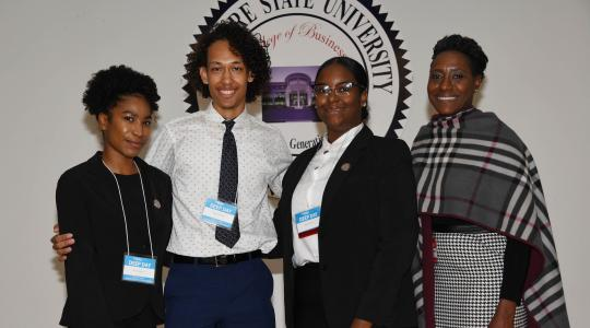 <p>The Edwards Team won first place in the 2019 DEEP Day Business Case Competition. (L-r) Margarita Isbell, Madison Edwards, Anonda Speaks, and their coach Dr. Francine Edwards, dean of the College of Humanities, Education and Social Science.</p>
