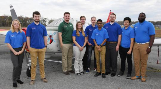 <p>The first-place Hornet Flight Team -- (l-r) Gabrielle Chuke, Sam Strauss (team captain), Kyle Longhany, Shelbe Jarrett, Michael Rogers (team safety officer) Colin Twardus, Jay Shah, Nick Jones, Christopher Guerra-Morales and Dante Russell.</p>