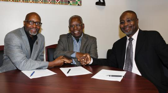 <p>(L-r) Ezrah Aharone, director of the University&#039;s Center for Global Africa; Kojo Yankah, founder of the African University College of Communications in Ghana; and Dr. Akwasi Osei, associate dean of the College of Humanities, Education and Social Sciences, shake hands after signing a collaboration agreement between the two institutions.</p>