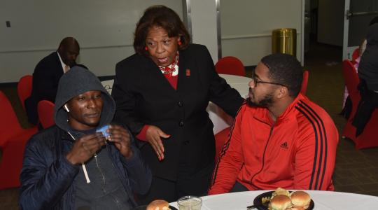 <p>University President Wilma Mishoe chats with two graduating seniors during the Dec. 13 Senior Send-Off Reception in the MLK Jr. Student Center.</p>