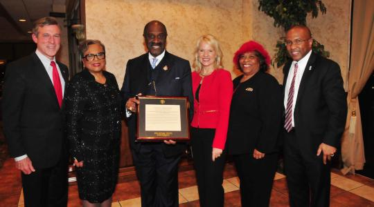 <p>(L-r) Gov. John Carney, Rev. Dr. Jessica Kendall Ingram and her husband Bishop Gregory G.M. Ingram, Lt. Gov. Bethany Hall-Long, DSU Board of Trustees member Wilma Mishoe and DSU President Harry L. Williams, who presented the Ingrams with commendation from DSU.</p>