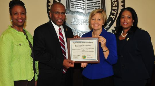 <p>(L-r) Dr. Marsha Horton, dean of the College of Education, Health and Public Policy; DSU President Harry L. Williams; Marianne Carter, director of the Del. Center for Health Promotions; Dr. Michelle Fisher, director of DSU Health Service, display the national award DSU received for its no smoking policy on campus.</p>