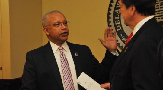 <p>Norman D. Griffiths is sworn in as a new trustee by Tom Preston, interim general counsel, during the DSU Board of Trustees' Jan. 30 public meeting.</p>
