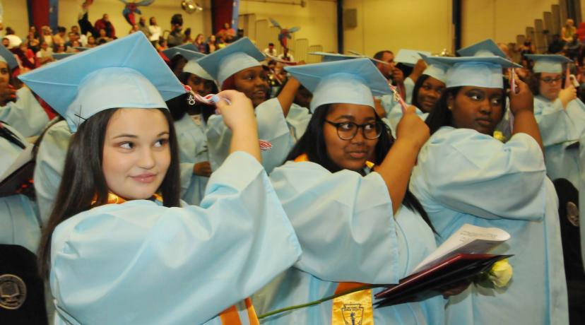 <p>Members of the Class of 2018 turned their tassels as the traditional end to the first-ever commencement for the Early College High School.</p>