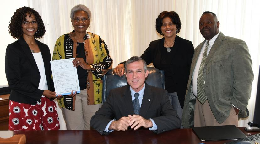 <p>Gov. John Carney poses with the NASW-DE subcommittee -- all DSU folks -- who were instrumental in the passage of HB 311. Standing from l-r: Dr. Sheridan Kingsberry and Dr. Marlene Saunders holding the signed legislation, along with Dr. Fran Franklin and Philip Thompson.</p>