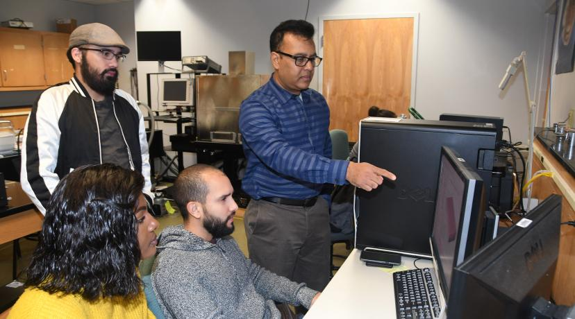 <p>Dr. Mukti Rana (r), principle investigator of the grant, will provide these students -- (l-r) Larine Mbabit, Jaime Cardona and Kevin Diaz -- and others some hands-on research experience through this project.</p>