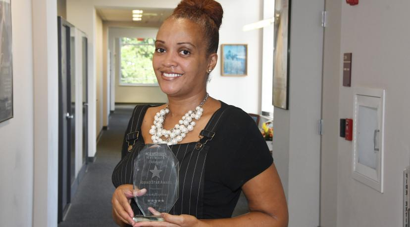 <p>Dawn Hopkins with her DAWN Rising Star Award.</p>