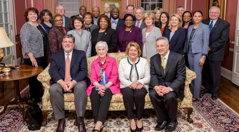 <p>University President Wilma Mishoe and Provost Tony Allen (both in standing center) pose with other presidents and administrators whose institutions are a part of the Campus Compact Mid-Atlantic. During a Nov. 8 ceremony, the Compact presented Dr. Allen with its Civic Leadership Award.</p>