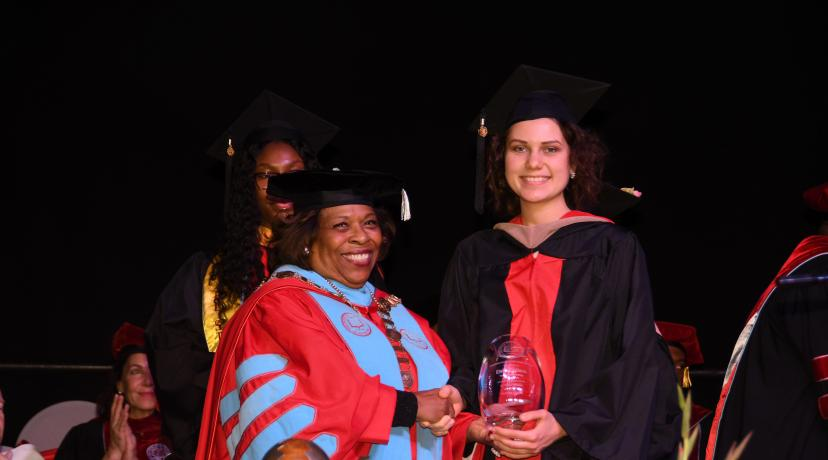 <p>University President Wilma Mishoe stands with Elvira Galieva, who she presented both the Presidential Academic and Leadership awards during the December Commencement Ceremony.</p>